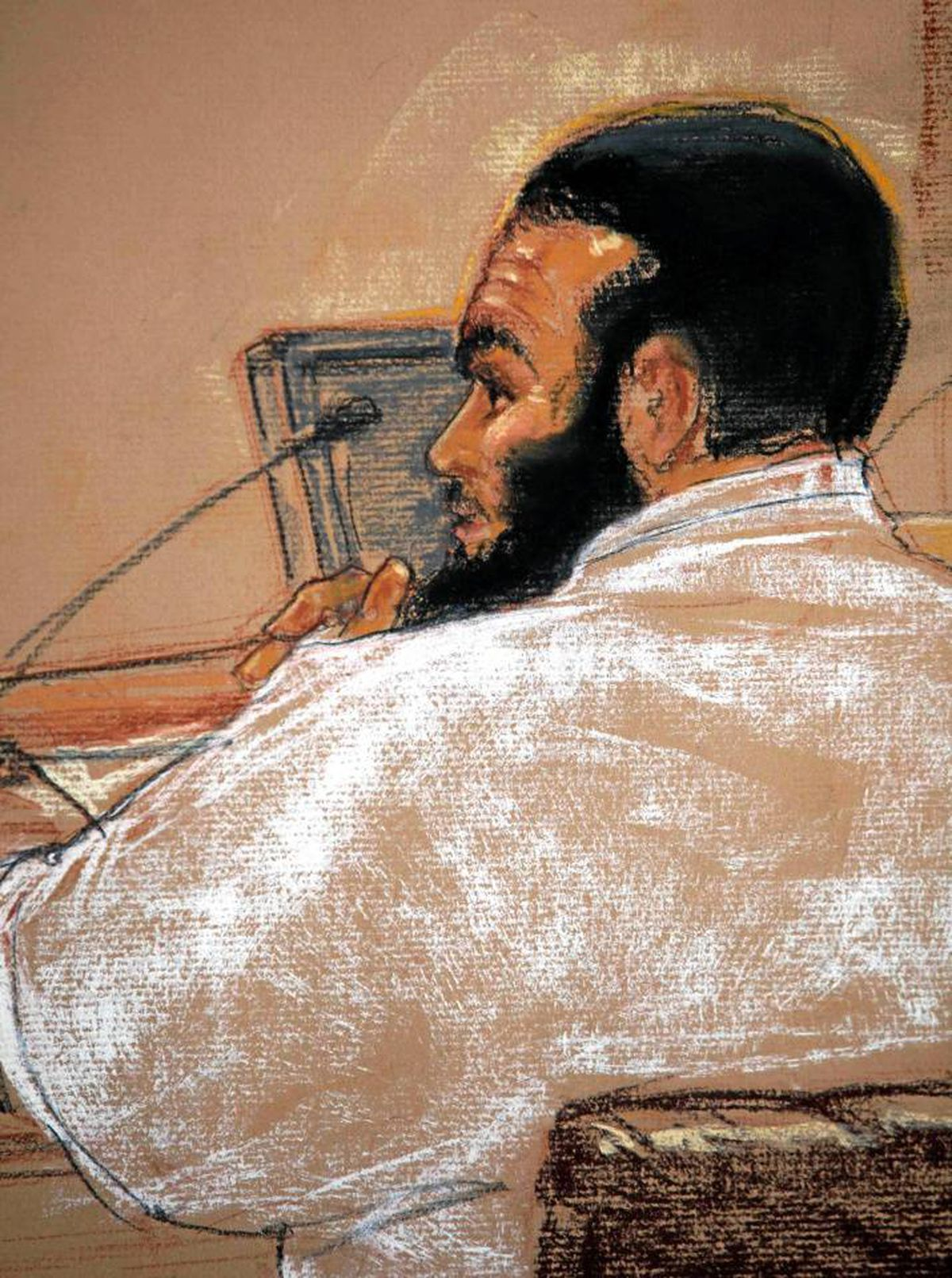 FILE--In this photo of a sketch by courtroom artist Janet Hamlin and reviewed by the U.S. military, Canadian defendant Omar Khadr attends a hearing in the courthouse for the U.S. military war crimes commission at the Camp Justice compound on Guantanamo Bay U.S. Naval Base in Cuba, on July 15, 2009.
