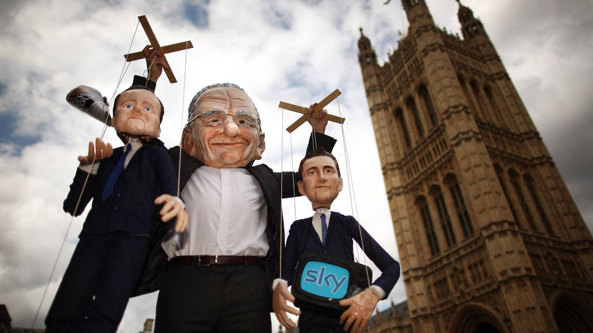 Dummies and puppets representing Prime Minister David Cameron (L) and Culture Secretary Jeremy Hunt (R) are held aloft by Rupert Murdoch at the launch of the campaign group Hacked off near Parliament on July 6, 2011 in London, England. The Prime Minister has promised that there will be a public inquiry into phone hacking carried out by journalists at The News of the World newspaper.
