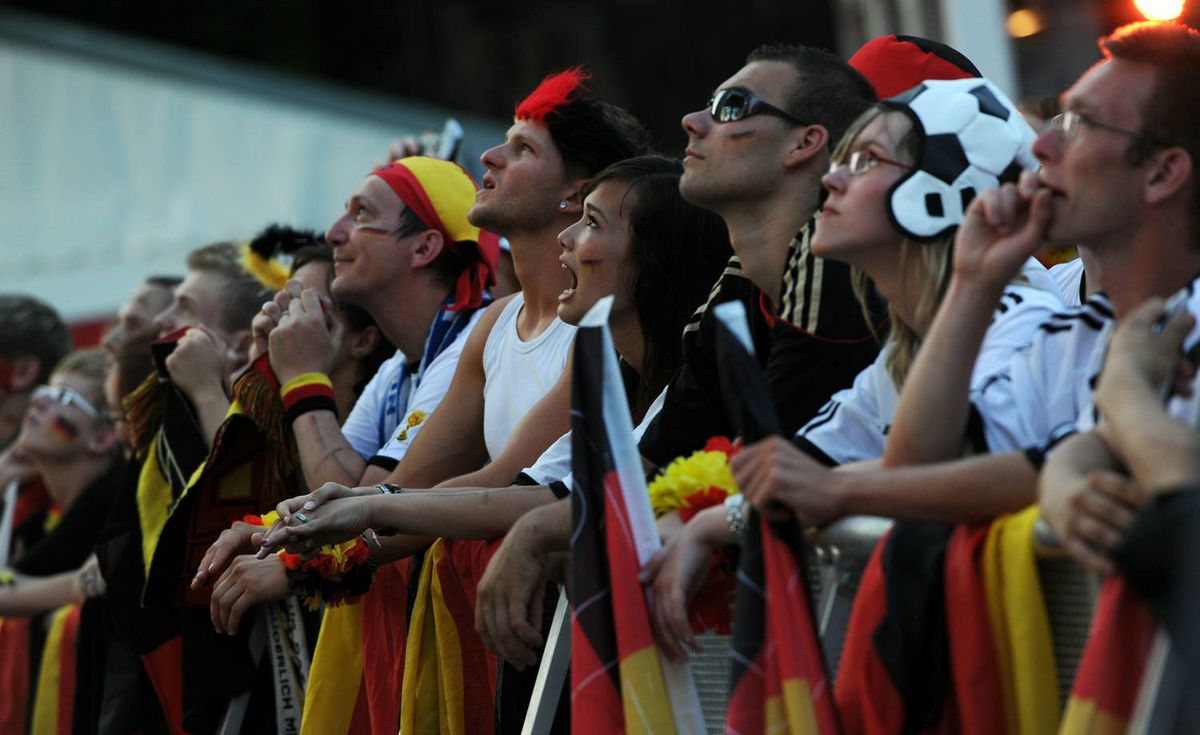 "Fans of the German national football team cheer during the public viewing of the FIFA World Cup match for third place Uruguay vs Germany at the ""Fanmeile"" (Fan Mile) in Berlin on July 10, 2010. Getty Images / JOHANNES EISELE"