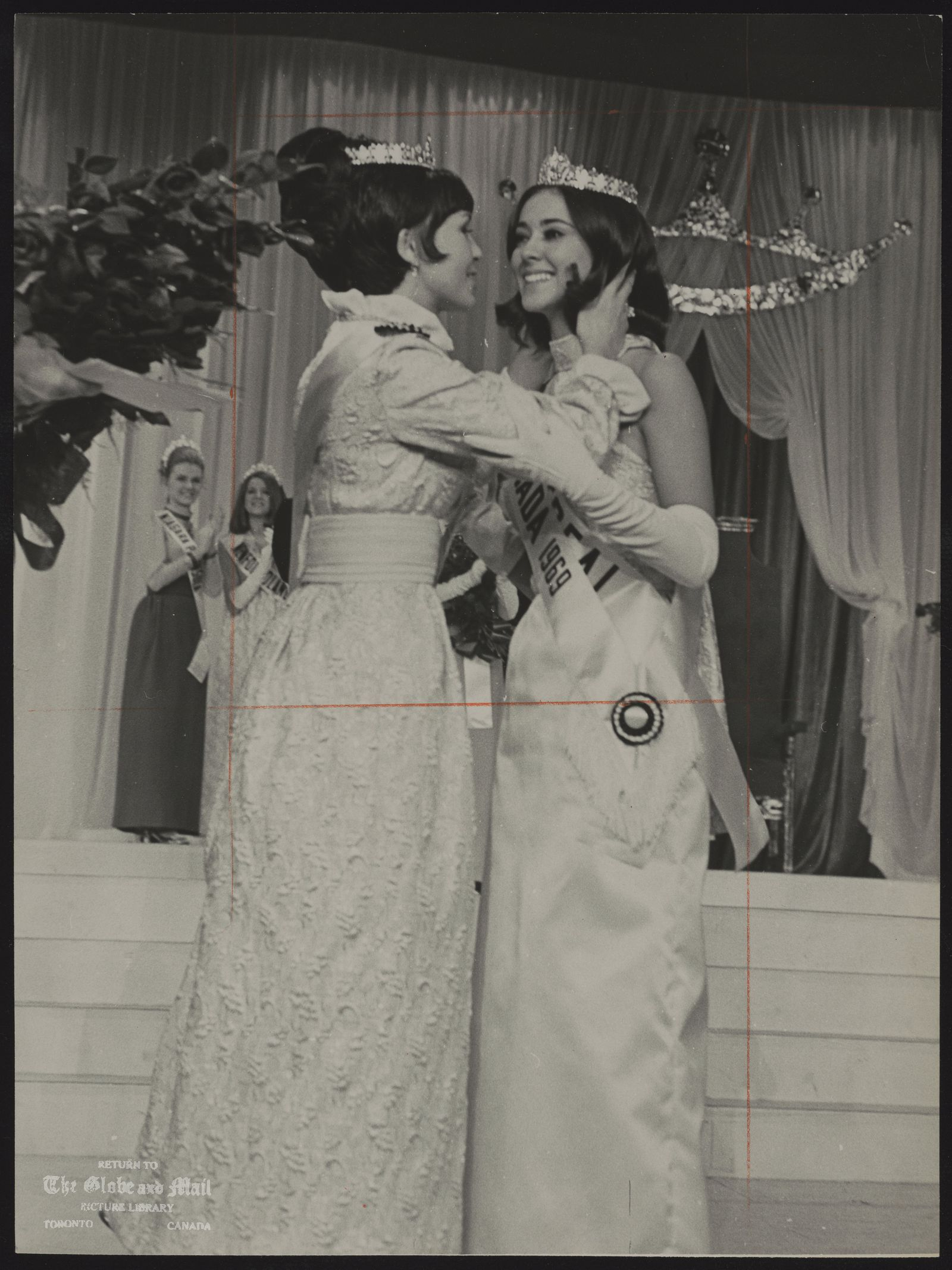 BEAUTY CONTESTS MISS CANADA Marie BEAULIEU. Montreal Miss Canada 1969 Carol MacKinnon Miss Canada 1968, congratulates Marie Beaulieu 17 after Marie was named Miss Canada 1969 in Toronto last night