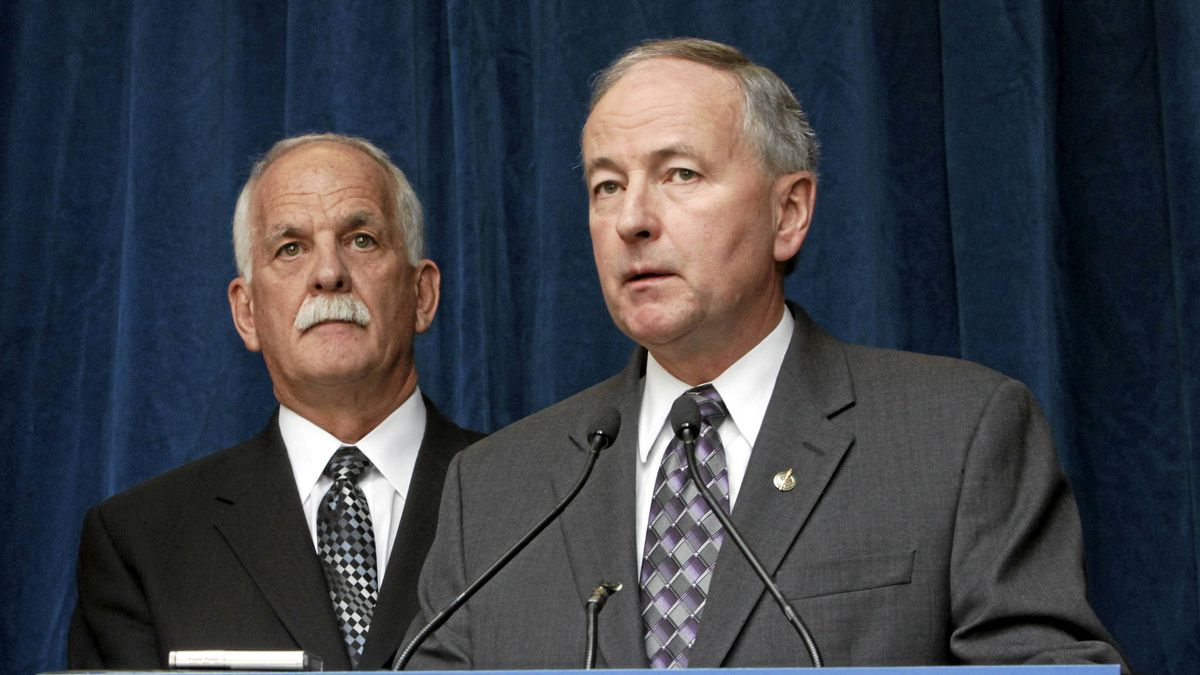 Public Safety Minister Vic Toews (left)and Justice Minister Rob Nicholson take part in a news conference to announce measures protecting children from internet predators, in Ottawa, Tuesday, Feb. 14, 2012.