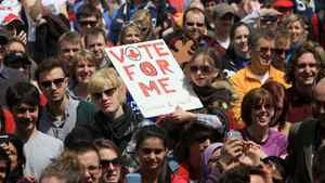 """Patrick Magee holds up Samara Leger, 9, during a pre-election gathering in London, Ont., Saturday, April 30, 2011. About 1,000 people showed up for a """"Vote Mob"""" to encourage people to exercise their right to vote in the federal election."""