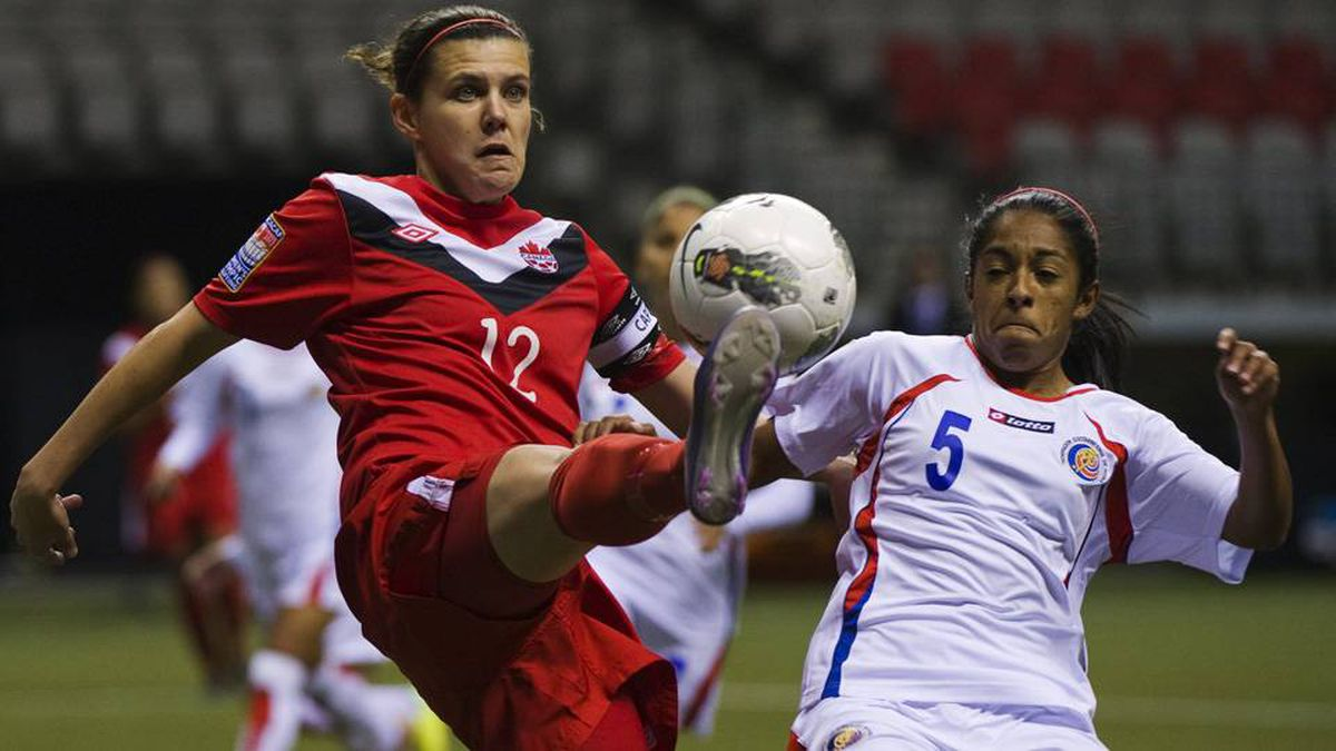 Costa Rica's Diana Saenz and Canada's Christine Sinclair try to control the ball during the first half of their CONCACAF women's Olympic qualifying soccer match in Vancouver.