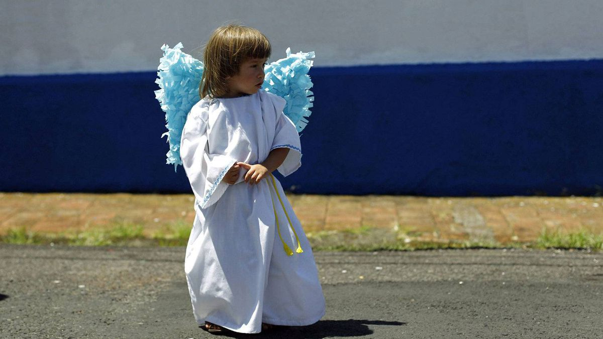 A child dressed as an angel takes part in the traditional Via Crucis (Way of the Cross) procession on Good Friday in Heredia, 15 km of San Jose April 6, 2012.