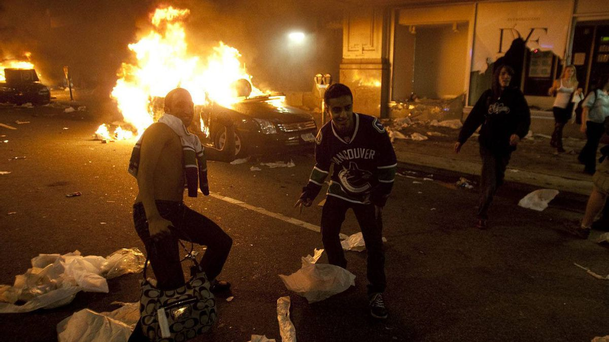 Cars burn during a riot after the Canucks lost to the Boston Bruins in Game 7 of the Stanley Cup Final.