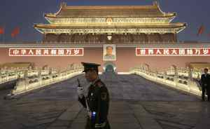 Chinese paramilitary police officer stands guard in front of Tiananmen gate in Beijing, China, Tuesday.