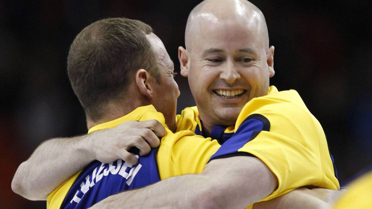 Alberta skip Kevin Koe, right, celebrates with lead Nolan Thiessen after they defeated Ontario to win the Tim Hortons Brier curling championships in Halifax. Shaun Best/Reuters