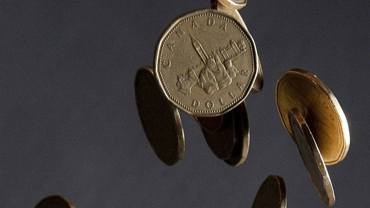 Canadian dollars (loonies) fall through the air in a photo illustration in Vancouver, B.C. Thursday, Sept. 22, 2011.