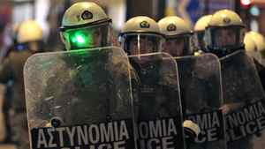 Police in riot gear descend on an anti-austerity protest outside the Greek parliament in Athens on Feb. 19, 2012.