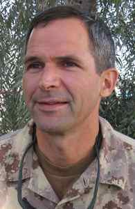 Lt.-Gen. Michel Gauthier, commander of Canada's overseas military operations, listens to a reporter's question at Kandahar Airfield on Friday Jan. 19, 2007. Gauthier was visiting troops on a two-day inspection during a lull in fighting Taliban militants. He said no more Canadian infantry will be deployed in the Afghan mission, but admitted more support elements, such as artillery, are on the way.