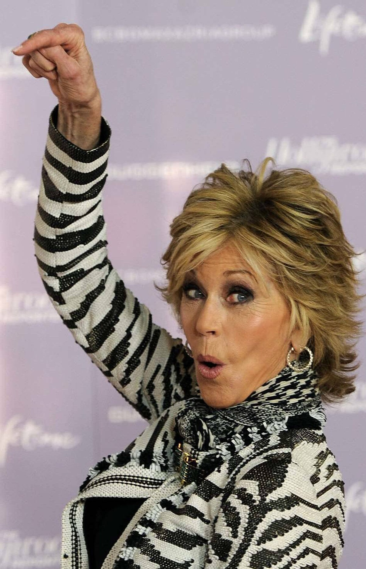 """""""Loser!"""" says Jane Fonda at The Hollywood Reporter's 20th annual Women in Entertainment Breakfast in Beverly Hills last week."""