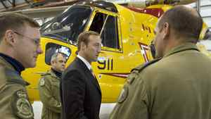 Defence Minister Peter MacKay speaks with search-and-rescue personnel in front of a Cormorant helicopter in Halifax on Sept. 12, 2007.