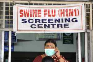 An Indian woman, wearing a mask, talks on her mobile phone outside the H1N1 swine flu screening centre at the Government Gandhi Hospital in Hyderabad on August 7, 2010. On august 10, 2010 the World Health Organisation was assessing whether it should lift the swine flu pandemic alert after scientists presented their latest advice on the waning outbreak.