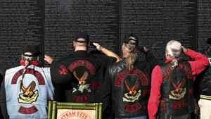 Veterans salute at the Vietnam Veteran's Memorial on Veteran's Day in Washington, November 11, 2010.