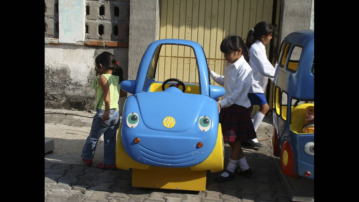 Gary Ockenden photo: Girls selecting cars - While in Barra de Navidad Mexico this week, we watched these young schoolgirls select their rides. In fact, I contributeed a few pesos to them for the 2 peso fare to start one of these vehicles.
