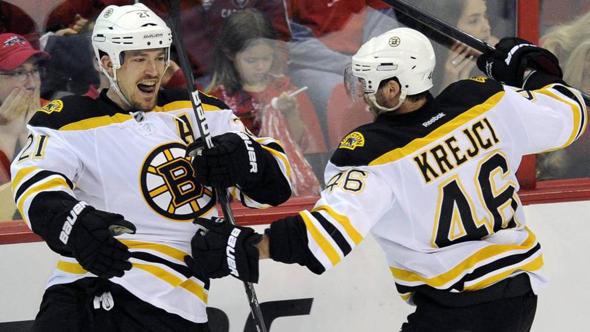 Boston Bruins defenseman Andrew Ference (21) celebrates his goal with David Krejci (46), during the third period of Game 6.