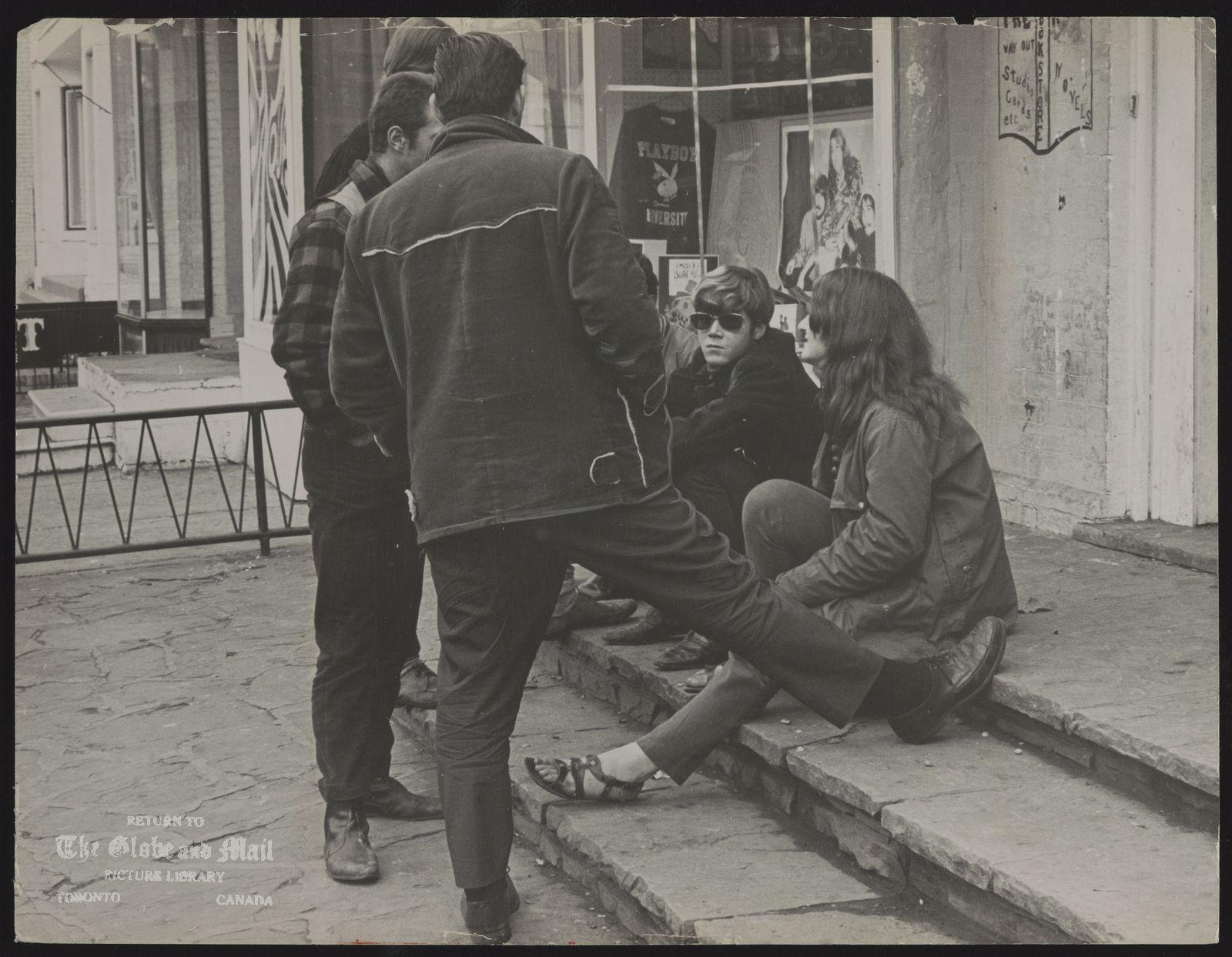 YORKVILLE Hippies conversing in Yorkville yesterday. Girls in teens vanish in the village.