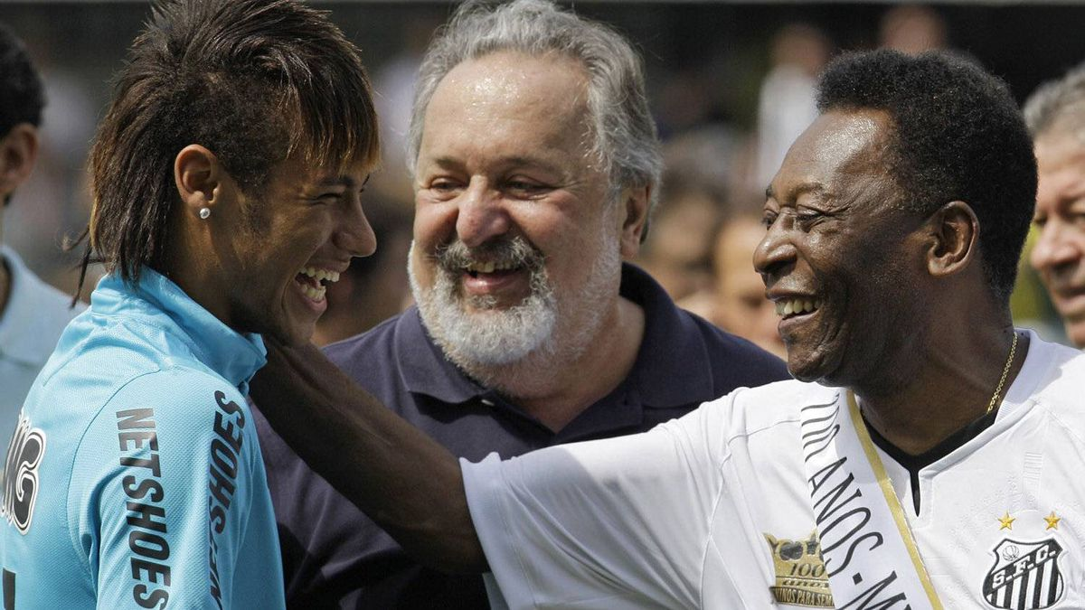 """Soccer player Neymar, left, and former soccer player Pele, right, shares a laugh during the centennial anniversary celebration of the team in Santos, Brazil, Saturday, April 14, 2012. Santos, the Brazilian club which ruled football with """"The King"""" Pele in the 1960's, turns 100 with a rich history to show, including many major titles and remarkable victories that make the club one of the most successful in football. At center is the team president, Luis Alvaro de Oliveira Ribeiro, (AP Photo/Nelson Antoine)"""