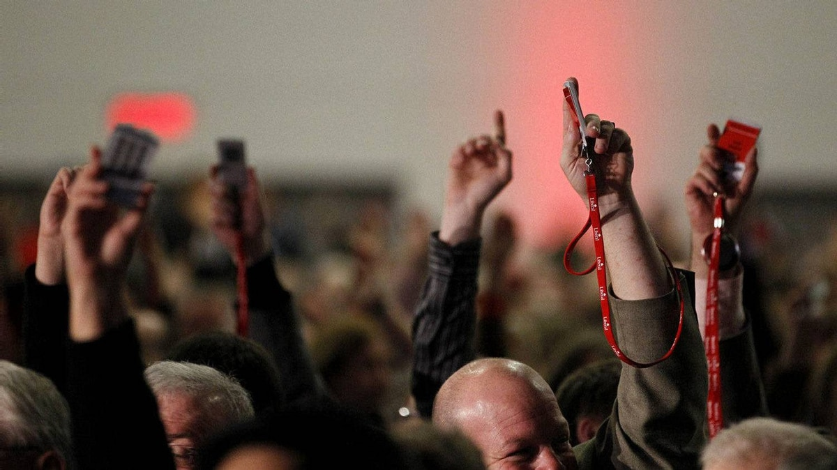 Delegates revert to a show of hands vote following problems with electronic voting on day two of the Liberal Convention in Ottawa on Jan. 14, 2012.