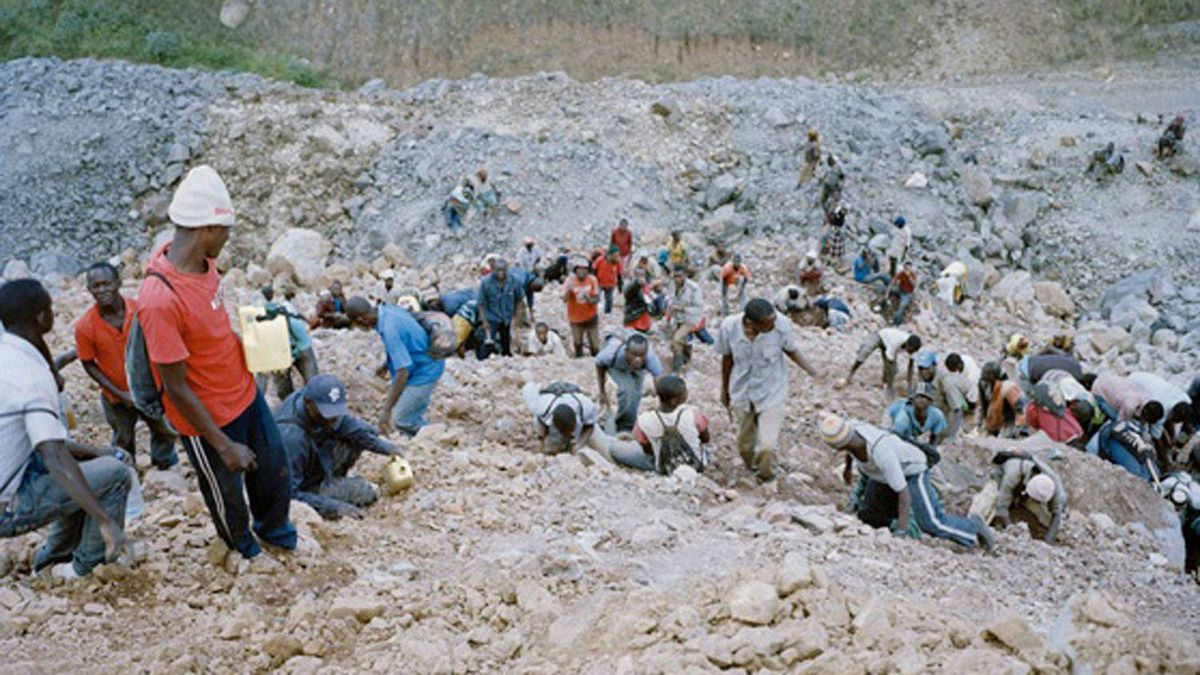 Mine intruders search through waste rock for gold deposits at the North Mara Mine in Tanzania.