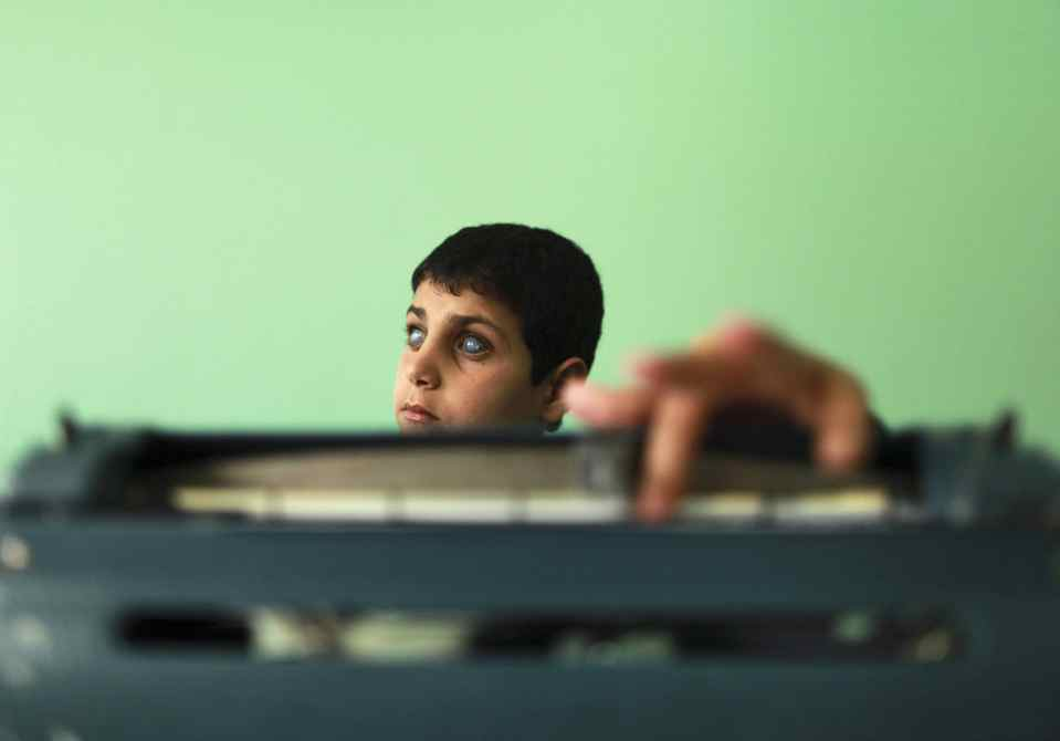 A blind Palestinian student uses Braille material during an English lesson in the United Nations Relief and Works Agency (UNRWA)-run al-Nour (Light) School for the Blind and Visually Impaired Children in Gaza City .