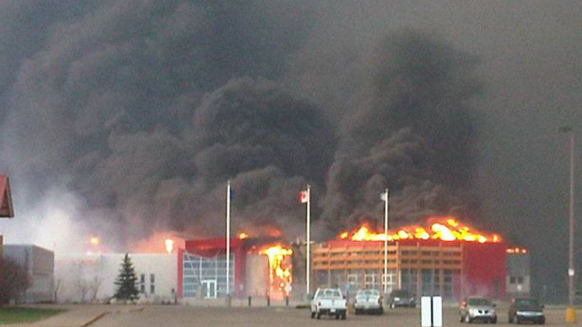 Slave Lake city hall burns. Photo taken by local radio station 92.7 Lake FM which has also burned down.