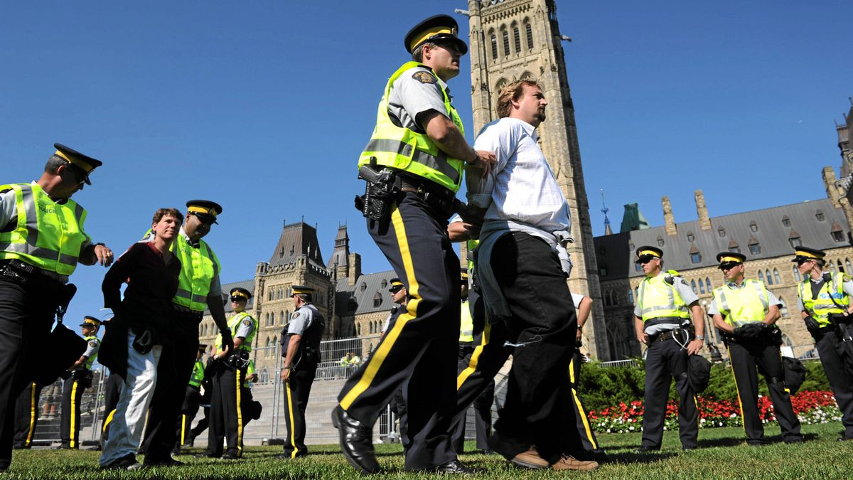Protesters are arrested as the Council of Canadians and Greenpeace Canada hold a rally featuring a civil disobedience sit-in against the tar sands on Parliament Hill in Ottawa on Sept. 26, 2011.