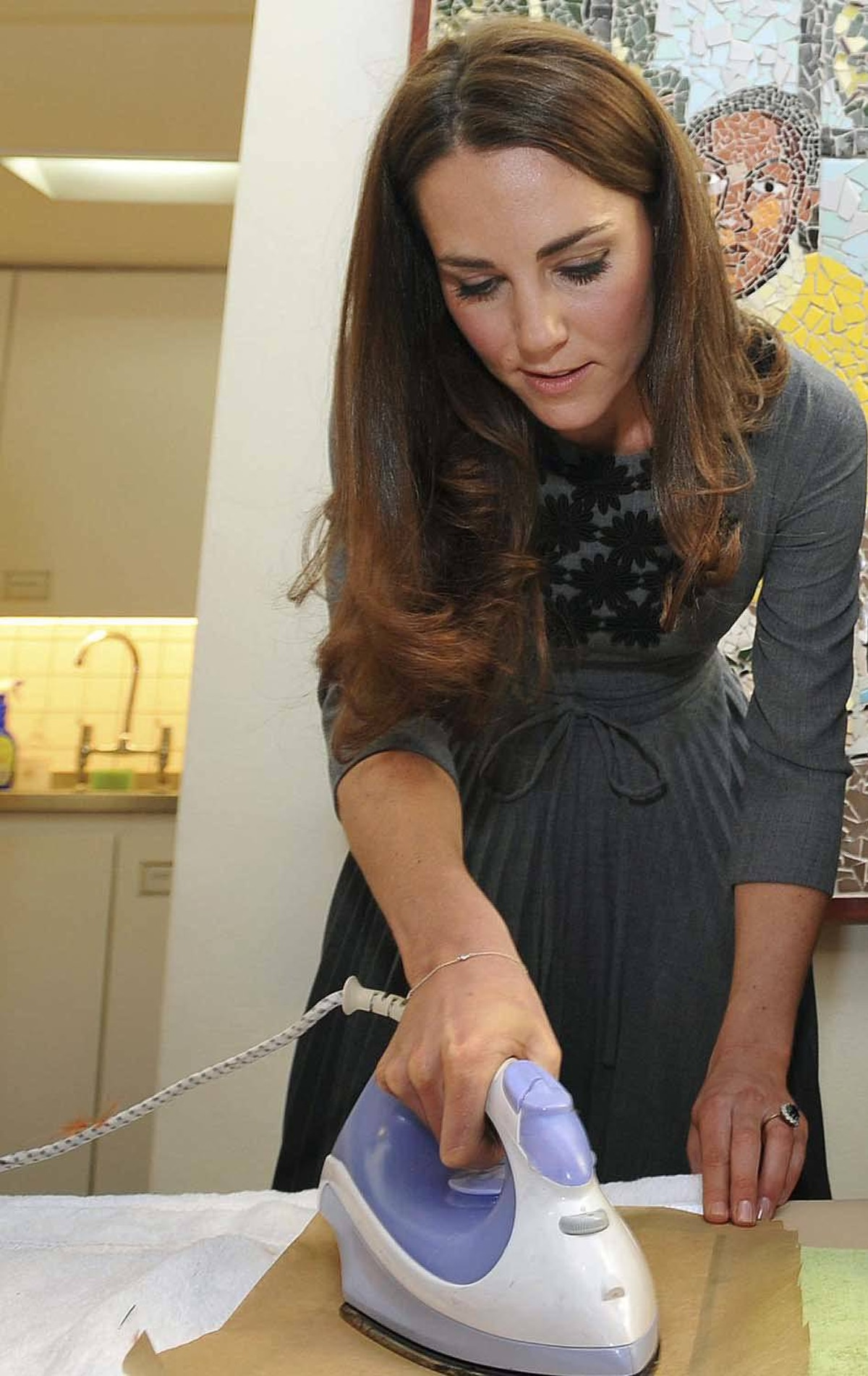 At the Dulwich Picture Gallery in London on March 15, she shows off her ironing skills in a grey Orla Kiely dress.