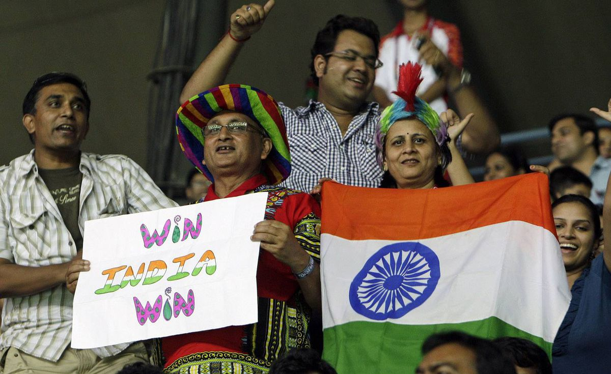 Indian fans cheer during the match between India's Sania Mirza and Australia's Anastasia Rodionova in the Tennis Women's Singles during the Commonwealth Games at the R.K. Khanna Tennis Complex in New Delhi, India, Saturday, Oct. 9, 2010. (AP Photo/Gurinder Osan)
