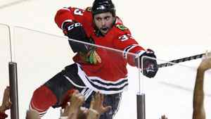 Chicago Blackhawks right wing Dustin Byfuglien celebrates after scoring goal against the San Jose Sharks during third period hockey action in Game 4 of the NHL Western Conference final Sunday, May 23, 2010 in Chicago. (AP Photo/Charles Rex Arbogast)