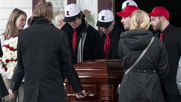 Members of the Lethbridge Bulls baseball team carry the casket of teammate Mitch MacLean at his funeral in Winsloe, PEI, on Dec. 22, 2011.