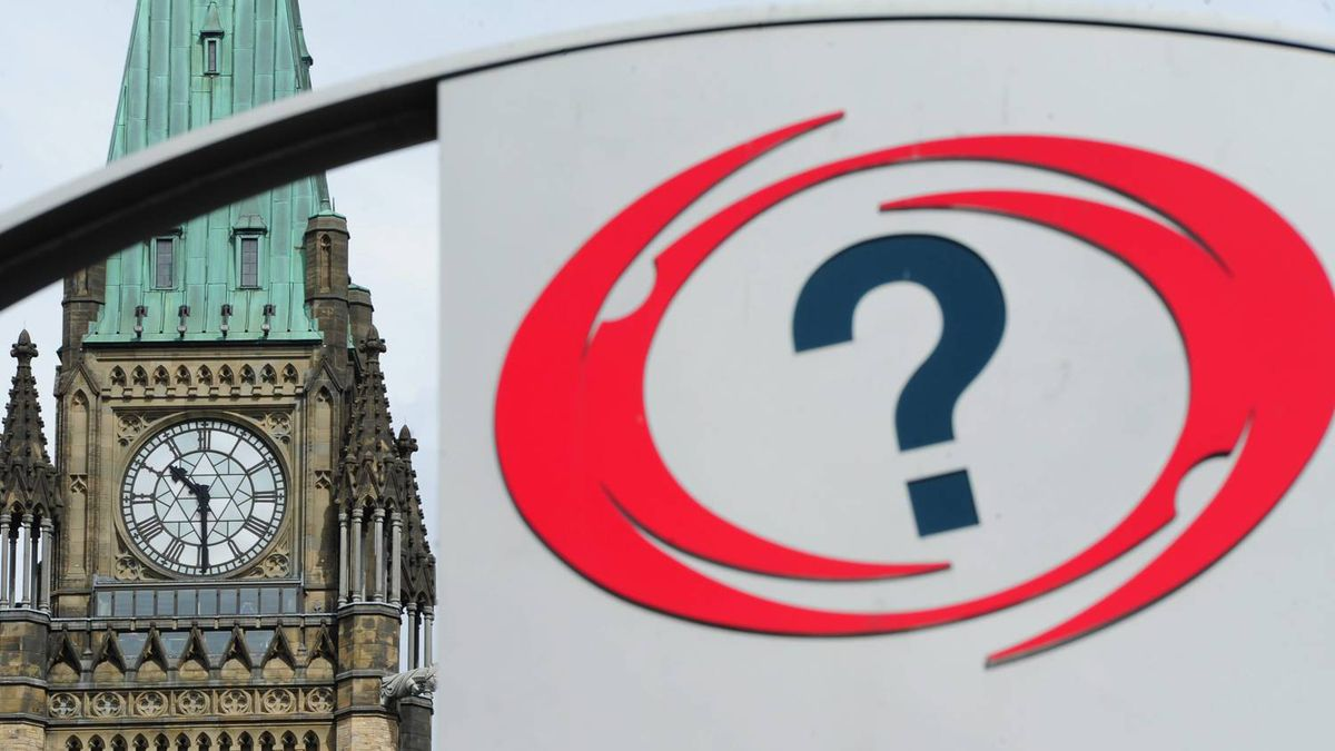 A National Capital Commission information sign sits across from the Peace Tower in Ottawa on April 28, 2011.