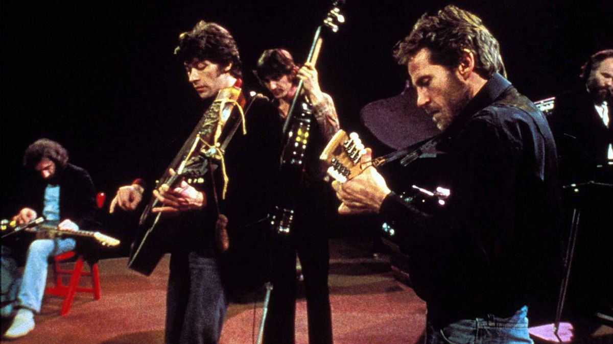 "Another scene from Scorsese's ""The Last Waltz,"" with Helm on the foreground playing the mandolin."