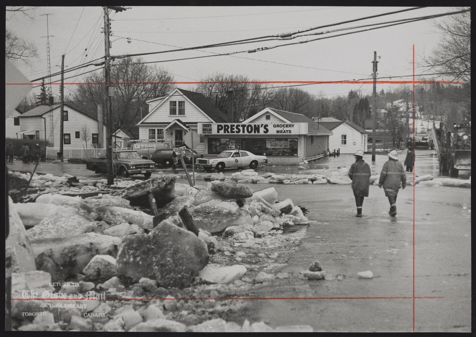 The notes transcribed from the back of this photograph are as follows: Large ice slabs clutter street in the aftermath of Credit River flooding in Glen Williams. The general store was hit by a foot of river water