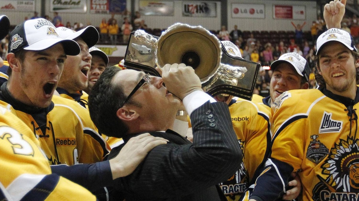 Shawinigan Cataractes head coach Eric Veilleux kisses the trophy cup after his team defeated the London Knights during their Memorial Cup final ice hockey game in Shawinigan, Quebec, May 27, 2012. REUTERS/Mathieu Belanger