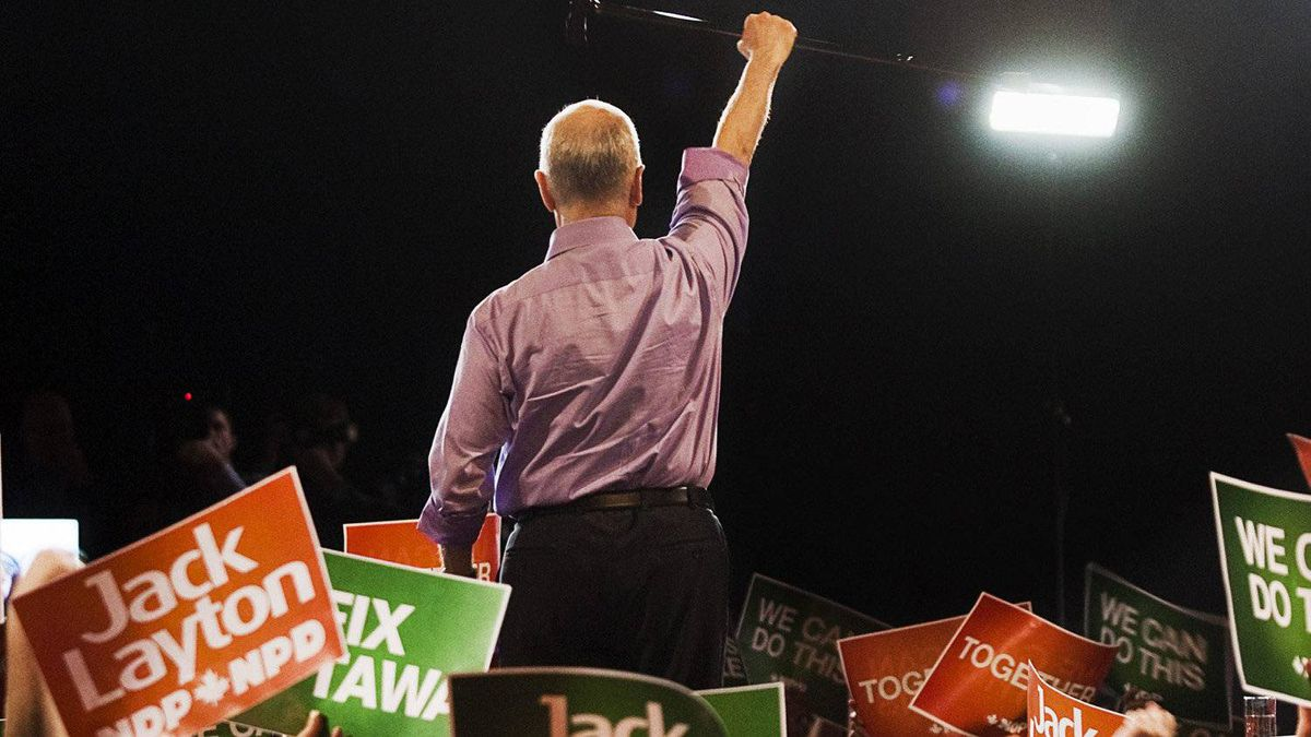 NDP Leader Jack Layton raises his cane to the crowd at a campaign rally in Burnaby, B.C. on Saturday, April 30, 2011.