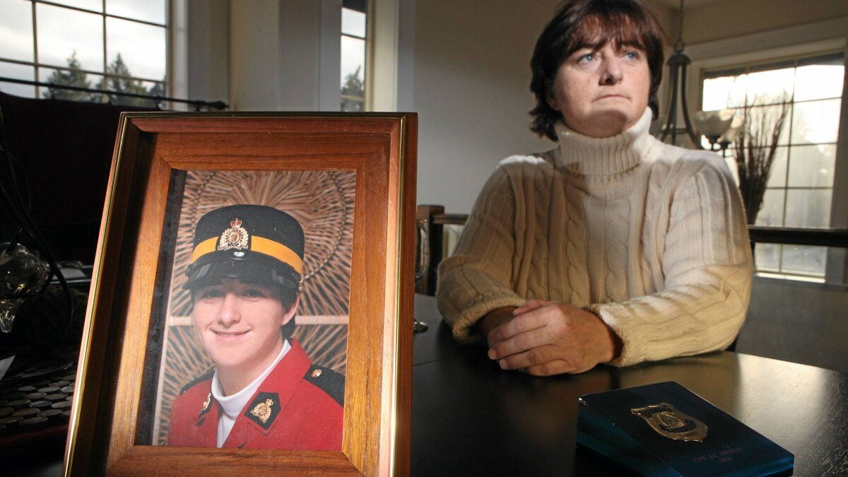 A framed photo of recently graduate RCMP Constable Janet Merlo in August, 1991, seen here at her home in Nanaimo,BC, left the force in 2010 after years of dealing with sexual harassment issues that the force ignored.