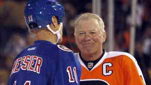 Philadelphia Flyers Bob Clarke (16) smiles at the New York Rangers Mark Messier before a face-off during the third period in the 2012 NHL Winter Classic Alumni ice hockey game at the Ballpark in Philadelphia, Pennsylvania, December 31, 2011. REUTERS/Tim Shaffer