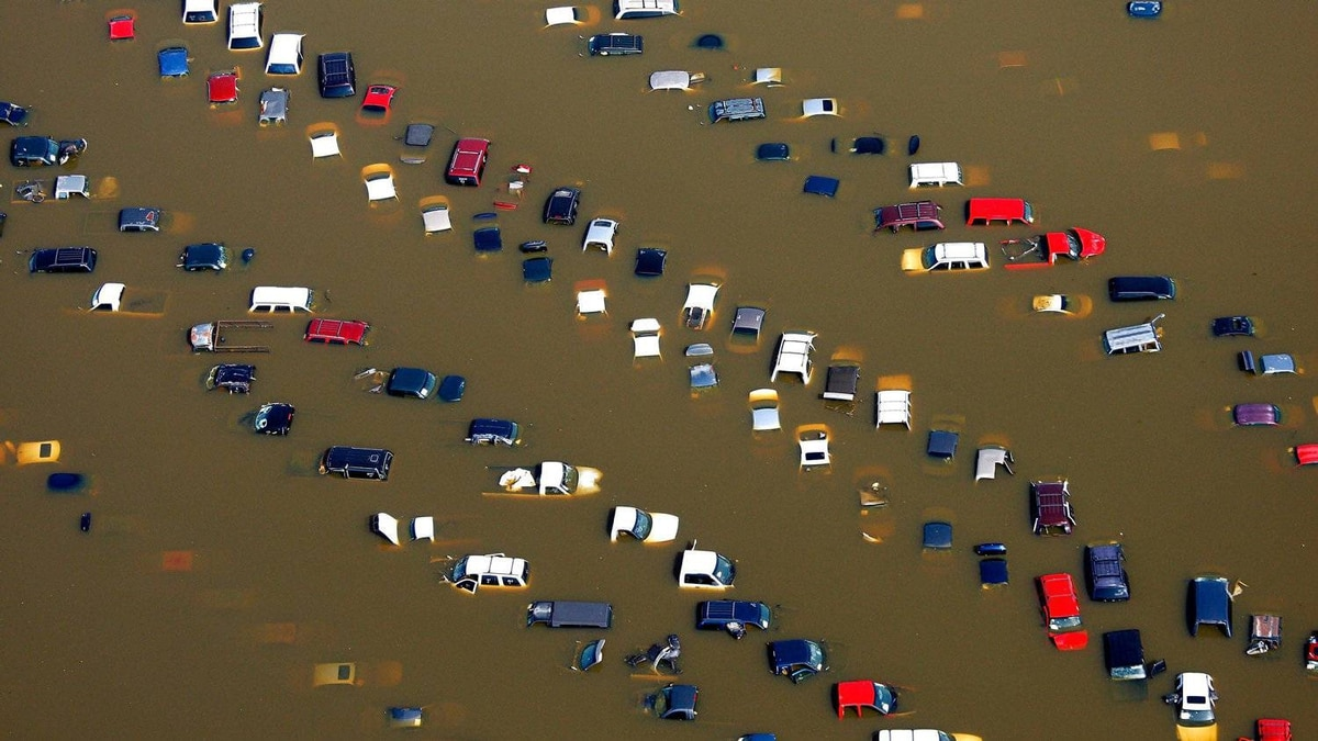 Cars stand submerged in overflow water from the Wolf River on McMiller Road in Memphis, Tenn. on Tuesday, May 10, 2011. After weeks of rising to historic levels the Mississippi River reached a crest just shy of the forecasted 48 feet at the Memphis gauge.