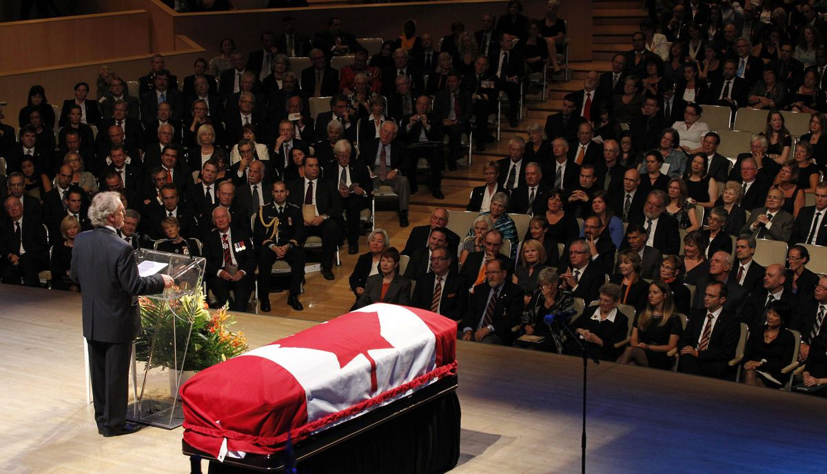 Former Canadian ambassador Stephen Lewis speaks as the coffin of the late NDP leader Jack Layton sits on stage during his state funeral.