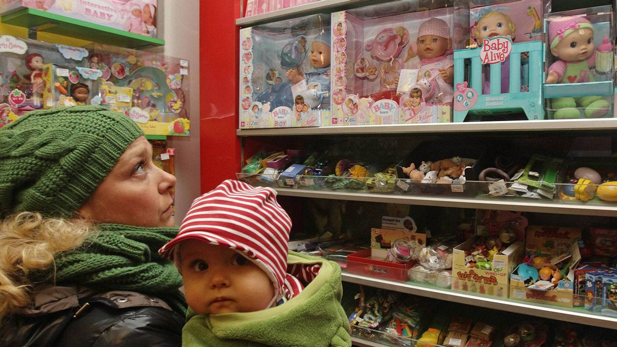 Sonja Schneider, 34, who works as a pharmaceutical representative and has one child, looks at toys inside Hilpert toy shop in Vienna. Rising prices, muted wage growth and austerity measures have squeezed disposable incomes across Europe.