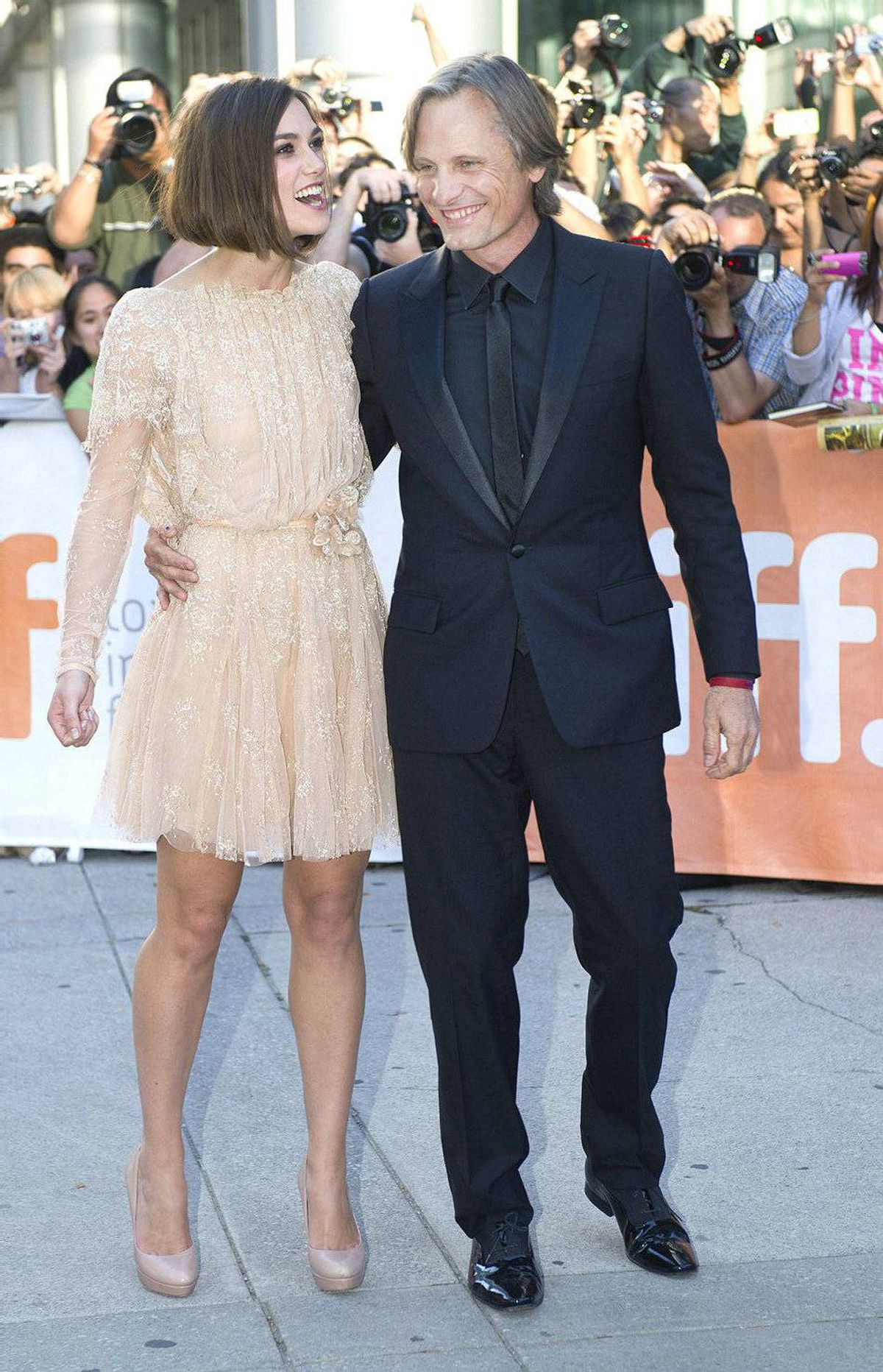 "Actors Keira Knightley, left, and Viggo Mortensen pose for a photograph on the red carpet before the screening of the new movie ""A Dangerous Method"" at the Toronto International Film Festival in Toronto on Saturday, Sept., 10, 2011."