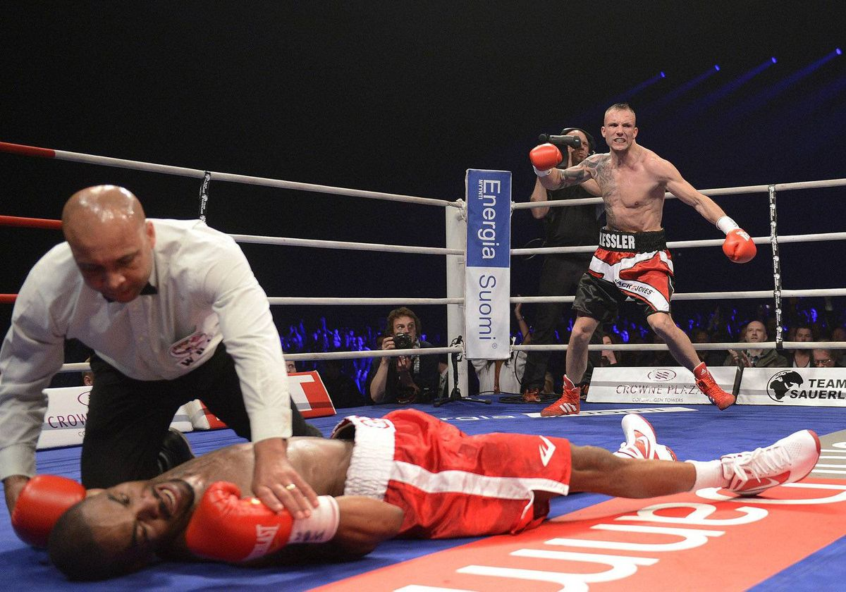 Denmark's Mikkel Kessler, right, clashes with Allan Green of USA, during a WBC Light Heavyweight World Championship clash Parken Stadium, Copenhagen, Denmark Sunday May 20, 2012. Mikkel Kessler won on knockout in the fourth round.