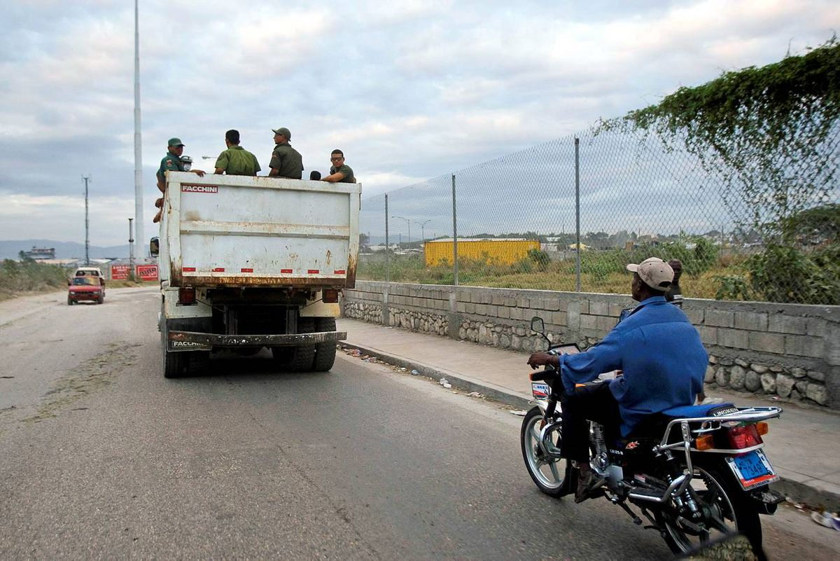 In this image released by the UN January 25, 2010 shows a truck with Colombian soldiers drives in downtown Port au Prince.