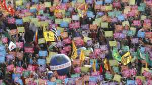 G20 demonstrators hold up signs near a sphere decorated as the planet with the message, 'Hello, the G20?' as they take part in a protest march against globalisation in Nice, France. REUTERS/Eric Gaillard