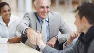 Senior businessman shaking hands.