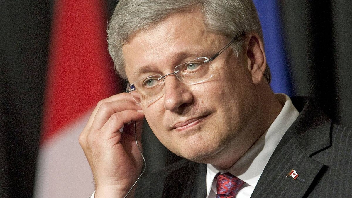 Prime Minister Stephen Harper listens to a question during a joint news conference with his Honduran counterpart in San Pedro Sula on Aug. 12, 2011.