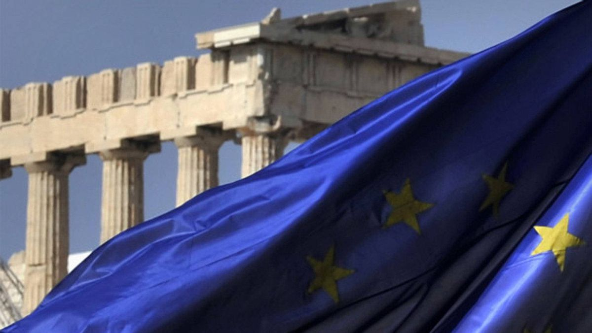 Columns of the Parthenon temple are seen behind an EU flag in Athens on Novemebr 4, 2011.