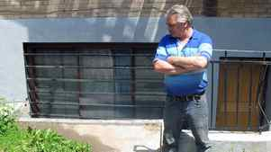Janitor Mike Nadeau stands outside an apartment complex in Montreal on May 30, 2012 near where he found a human torso inside a suitcase.
