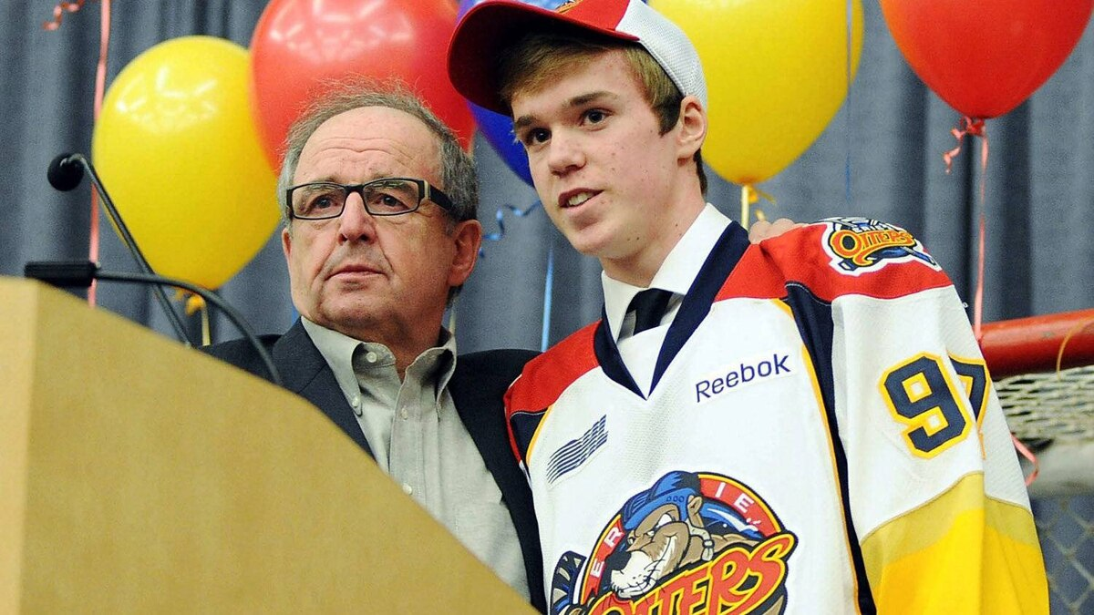 Erie Otters general manager Sherwood Bassin, left, introduces Connor McDavid as the No. 1 pick in the OHL Priority Selection during an OHL hockey draft party in Erie, Pa., Friday, April 6, 2012. (AP Photo/Erie Times-News, Janet B. Kummerer)